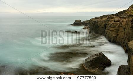 Cliffs on the sea coast, long exposure time