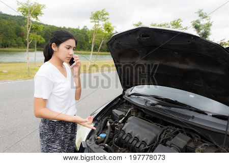 Woman After A Car Breakdown At The Side Of The Road