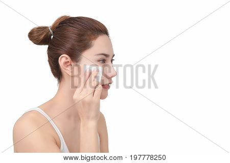 Skin care concept. Woman removing makeup from her face. with clipping path