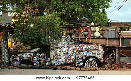 KEY WEST, FL - NOVEMBER 30, 2013: Old truck covered with bumper stickers at Bo's Fish Wagon restaurant in Key West, Florida