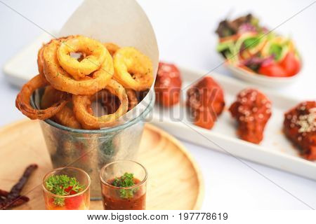 Homemade Crunchy Fried Onion Rings with Ketchup.