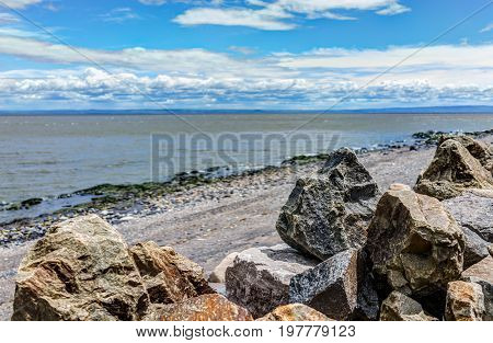 Closeup Of Rocks And Saint Lawrence River In Saint-irenee, Quebec, Canada In Charlevoix Region With