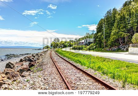 Railroad With Saint Lawrence River In Saint-irenee, Quebec, Canada In Charlevoix Region