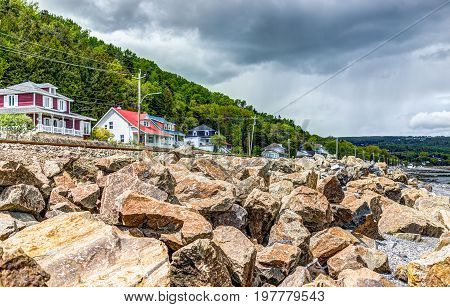 Saint Lawrence river with cityscape or skyline of Saint-Irenee Quebec Canada in Charlevoix region