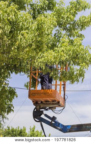 Utility Worker Replacing Cables 2
