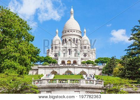 PARIS FRANCE - JUNE 6 2012: Sacre-Coeur is a Roman Catholic church and minor basilica dedicated to the Sacred Heart of Jesus in Montmartre in Paris France. It is a Parisian landmark.