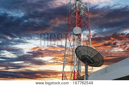 Telecommunication tower with Satellite dish, under sunset sky