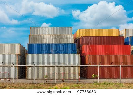 Handling container stack in shipping yard., Cargo and Shipping