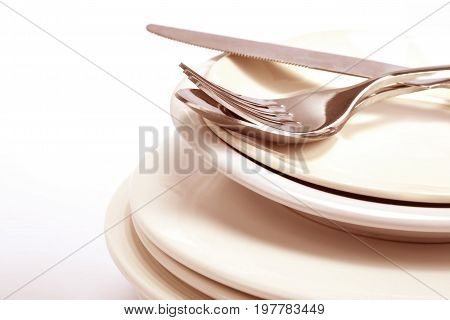close up the dinning the silverware fork spoon and knife with dish on white background and text space