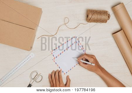 Sending a letter. Air mail envelope on the wood table