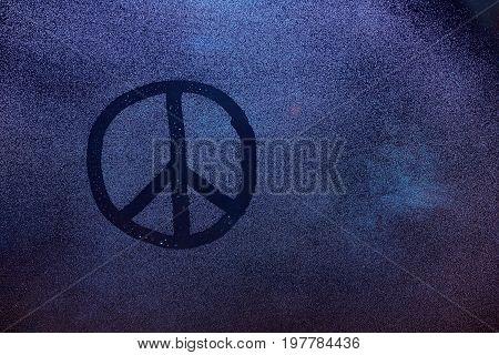 Peace symbol on fogged window. Rap sign on frozen window glass