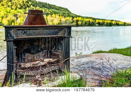 Wood Log Burning French Fireplace By River In Quebec Village