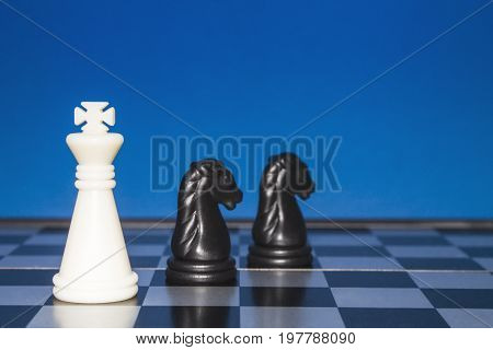 Chess As A Business. A White Figure Controls Two Black Horses.