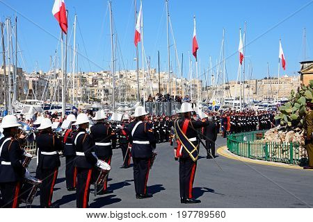 VITTORIOSA, MALTA - MARCH 31, 2017 - Freedom day celebrations with military personnel and a brass band by the Freedom Day monument Vittoriosa Malta Europe, March 31, 2017.