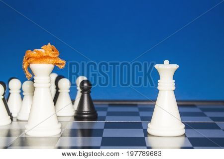 Chess As A Policy. White Figure With Red Hair With A Team Against A Lone White Figure.