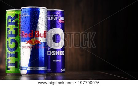 POZNAN POLAND - JULY 27 2017: Cans of popular global energy drinks beverages containing stimulant drugs and marketed as providing mental and physical stimulation