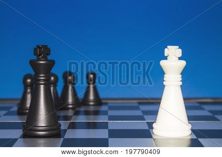 Chess As A Policy. Black Figure With A Team Against A Lone White Figure.