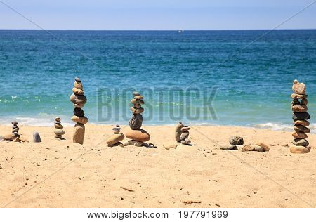 Stones Piled On Top Of One Another In Inuksuk Fashion