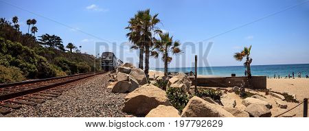 San Clemente CA USA - July 31 2017: Train moves along tracks that run through San Clemente State Beach in Southern California in summer. Editorial use.