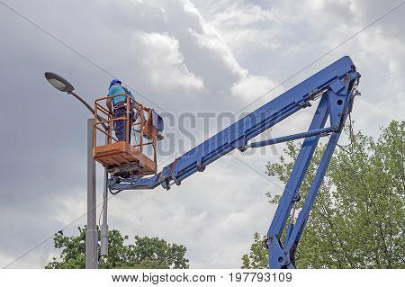 Worker In Lift Bucket