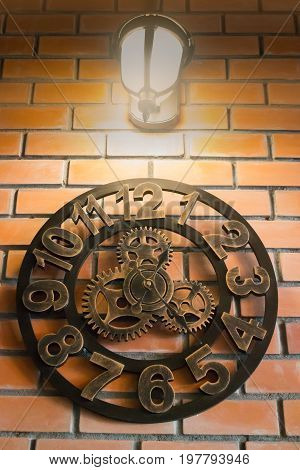 Vintage wall clock on brick room stock photo