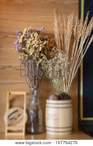 Ornamental basket of wheat on wooden table stock photo