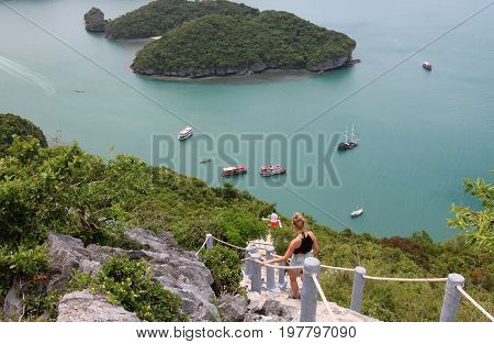 Tourists walking on nature trail on the mountain of Ang Thong archipelago islandThailand.