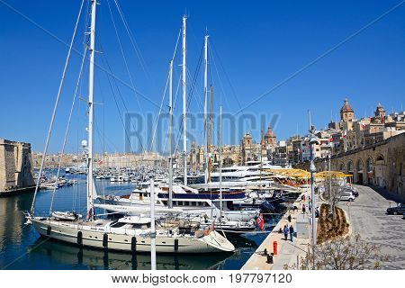 VITTORIOSA, MALTA - MARCH 31, 2017 - Elevated view of Vittoriosa marina and waterfront with views towards Senglea and Valletta Vittoriosa (Birgu) Malta Europe, March 31, 2017.