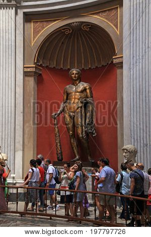 VATICAN, ROME, ITALY - JULY 15, 2017: Tourists and Hercules sculpture in Round Room of Pio-Clementino Museum in Vatican museums, Vatican city, Rome, Italy