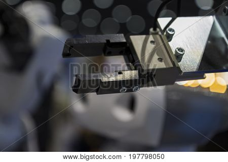 The mechanical robotic with blurr blackground arm ;Selective Focus