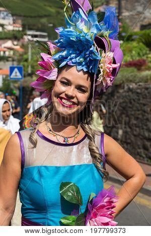 ESTREITO DE CAMARA DE LOBOS PORTUGAL - SEPTEMBER 10 2016: People wearing in traditional costumes at Madeira Wine Festival in Estreito de Camara de Lobos Madeira Portugal.