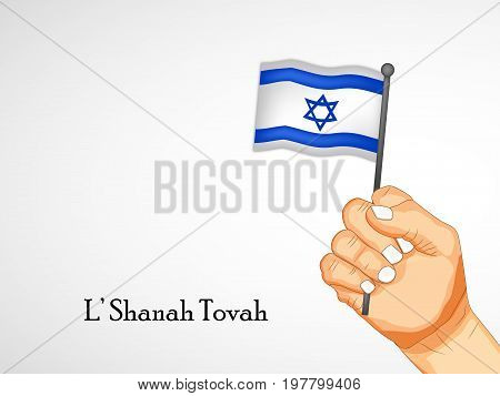 illustration of hand holding Israel flag with L'shanah tovah text on the occasion of Jewish New Year Shanah Tovah. Translation: a good year