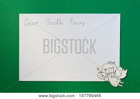 dental paper cut cute tooth fairy with copy space of letter for text isolated on green background