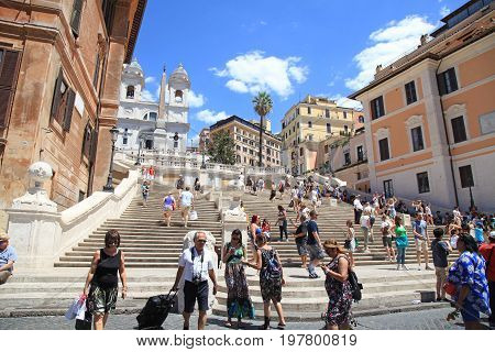 ROME, ITALY - JULY 16, 2017: Tourists in Piazza di Spagna on the Spanish Steps(Scalinata di Trinita dei Monti), Rome, Italy