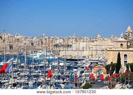 VITTORIOSA, MALTA - MARCH 31, 2017 - Elevated view of Vittoriosa marina and waterfront with views towards Valletta Vittoriosa (Birgu) Malta Europe, March 31, 2017.