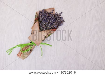 Creative mock up layout made of lavender branches with copy space on table homemade flat lay