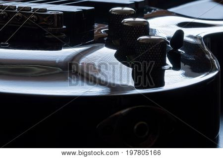 Electric Guitar At Black Background