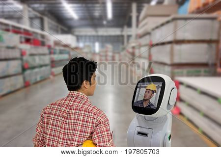 engineer use robot advisor technology to talk with boss or team mate for consult at store site to improve a work a futuristic robot help a work to easy