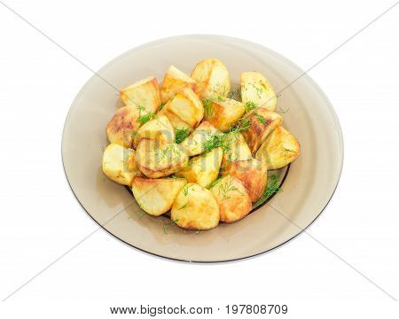 Serving of the country style fried potatoes sprinkled by chopped dill on the dark glass dish on a light background