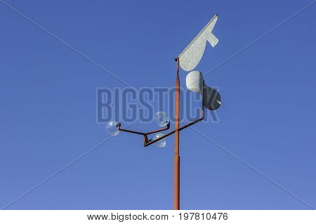 Vintage Wind Vane On Blue Sky 2