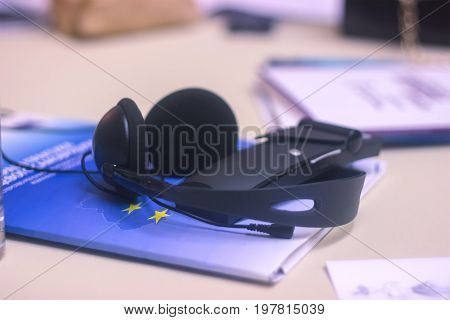 journalist work at a book with a voice recorder