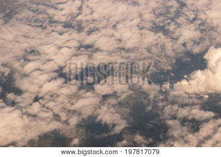 Aerial city view from above beautiful fluffy clouds