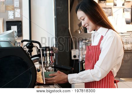 Young asian women Barista using coffee machine at counter in her cafe background small business owner food and drink industry concept