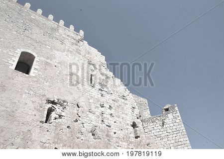 Old medieval stone ruins of a crusader castle walls - black and white art photo