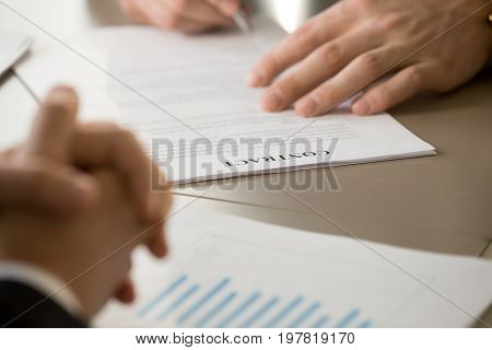 Businessman signing contract at meeting with partner, male hand putting signature on document, venture investing in startup, concluding consulting risk agreement, entering partnership, close up view