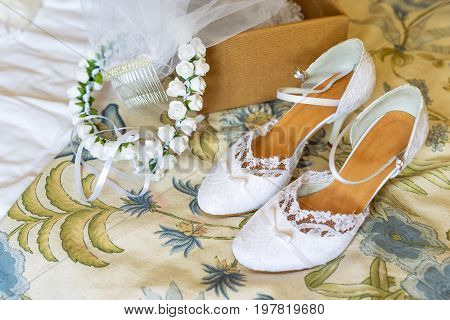 Wedding wreath and white bride shoes. Wedding accessories