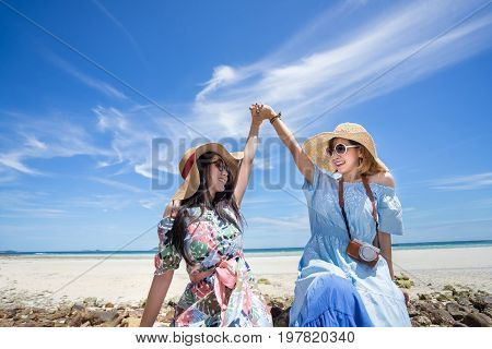 Young woman asian dual in hawaii dress with hat on sea beach summer fun and happy relax in vacation time
