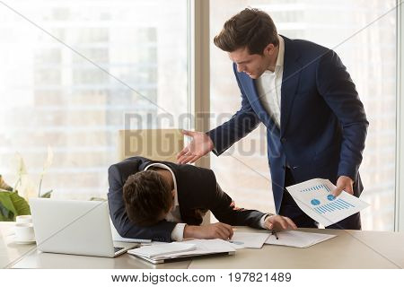 Bad angry boss yelling at male sad depressed employee, lying with face down on office desk, ineffective worker made mistake receiving reprimand from team leader, scolding for failure, missed deadline poster