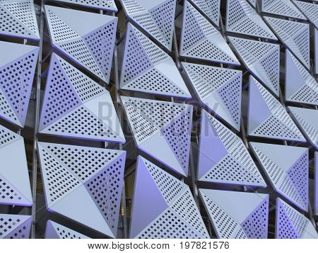 futuristic metal geometric cladding composed of angular metal sheets with triangle pattern