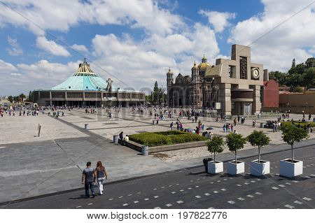 Mexico City Mexico - June 1 2014: People at the Basilica of Our Lady of Guadalupe with the old and the new basilica on the background in Mexico City Mexico